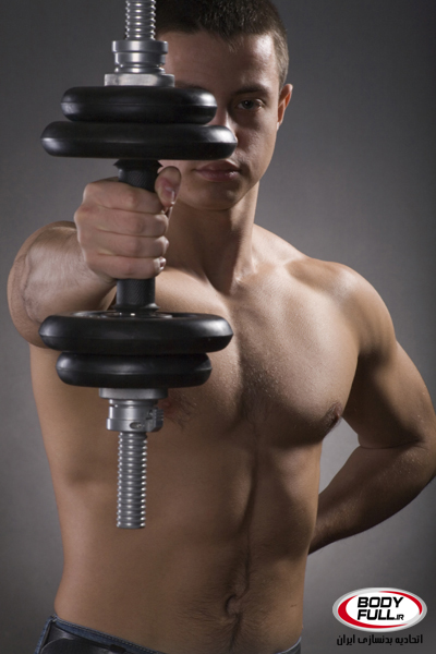 Young Sporty Man with Dumbbell